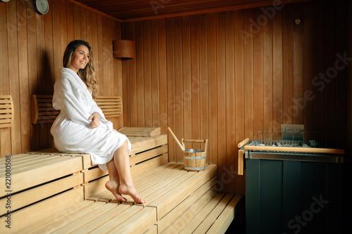 Leinwandbild Motiv Beautiful woman relaxing in sauna