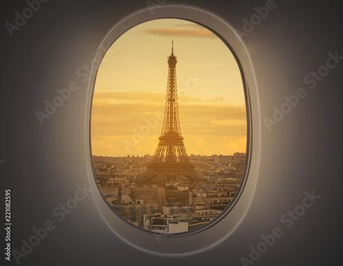 Fridge magnet Eiffel as seen through window of an aircraft.