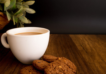 Homemade Chocolate Cookies Eat with hot Coffee on wooden background