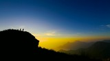 Silhouette traveller on Phu Chi Fa with Sunrise and Foggy Landscape, Thailand - 221089718
