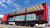 There is a loading to the truck trailer . Truck Trailer  . Cargo Transportation . Lorry horizontal .  Concept of wholesale  . fastening of freight in the trailer . distribution warehouse  - 221092375