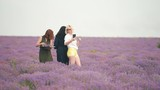 Three girls do selfie in a lavender field. - 221096935