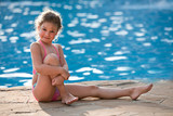 Beautiful graceful girl by the pool - 221130739