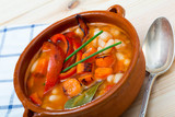 Soup of bean with boiled carrots, pepper and greens, served in bowl - 221133112