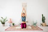 mindfulness, spirituality and healthy lifestyle concept - woman meditating at yoga studio - 221135731