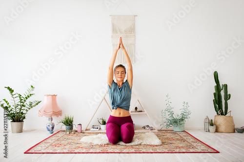 Poster mindfulness, spirituality and healthy lifestyle concept - woman meditating at yoga studio