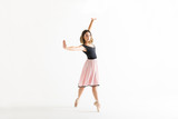 Confident Young Ballerina Dancing Gracefully On White Background - 221137348