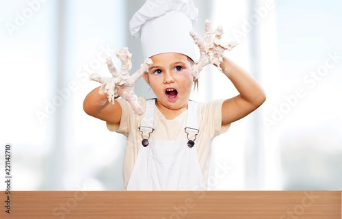 Little girl cooking - 221142710