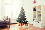 holidays and interior concept - artificial christmas tree and presents at home living room - 221143902