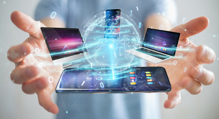 Modern devices connected in businessman hand 3D rendering © sdecoret