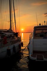 Marina with docked boats at the sunset © V&P Photo Studio