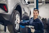 Auto car repair service center. Mechanic at work - 221156728