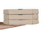 Female hands holding pizza boxes on white background - 221157708
