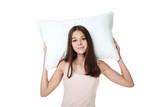 Young girl holding pillow on white background - 221158502