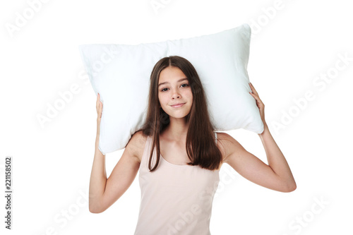 Young girl holding pillow on white background