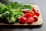 Wooden plank with vegetables for a vegetarian salad. - 221177717