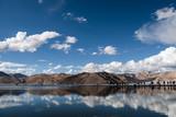 Himalaya mountain at Pangong Lake with reflection on water and people