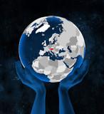 Austria on globe in hands - 221181139