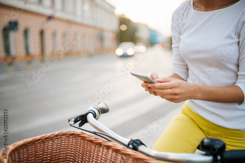 Texting while cycling in the city.