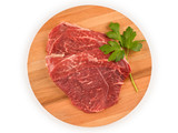 Raw meat for steak on wooden cutting board. Top view isolated with clipping path - 221190339