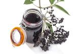 Elderberry Jam. Jar of homemade elderberry confiture and fresh fruits on white background - 221199535