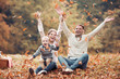 Happy family having fun in autumn forest - 221202382