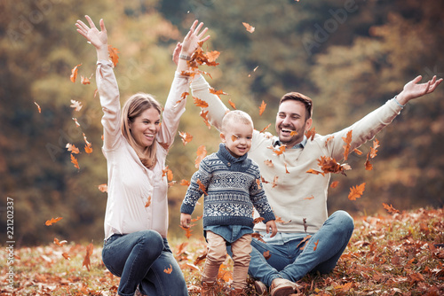 Happy family having fun in autumn forest - 221202337