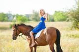 A beautiful girl rider drives a horse. Horse theme - 221203792