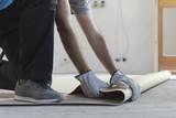 Contractor removing an old linoleum flooring - 221207150