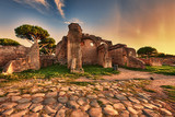 Sunset glimpse from cobblestones street in  Ancient Ostia ruins  - Rome - 221211128