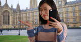 Close up of cute tourist taking selfie with smartphone by Westminster palace - 221226715