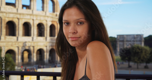 Portrait of tourist woman wearing tank top standing near the Roman Colosseum