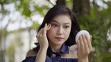 woman applying make up with powder puff - 221232151