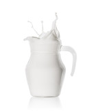 Splash of fresh milk in  glass jug - 221242571