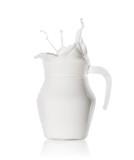 Splash of fresh milk in  glass jug
