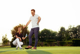Couple playing golf together on golf course - 221242930