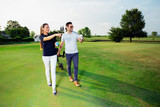 Young couple enjoying time on a golf course - 221242931
