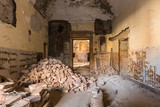 A pile of romanic bricks in a empty room - 221256966