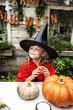 Leinwanddruck Bild - Little girl dressed up as a witch