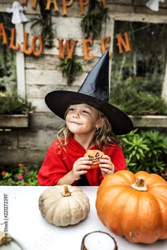 Leinwanddruck Bild Little girl dressed up as a witch