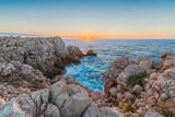 Punta Nati Lighthouse in Minorca, Spain. - 221280720