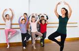 Young ballet dancers exercising in ballroom - 221281529