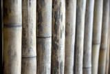 Wooden panel for barriers. Wood wall background, old brown tone bamboo plank fence texture for background.