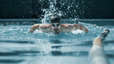 The dynamic and fit swimmer in cap breathing performing the butterfly stroke at pool. The young man. The fitsport, swimmer, pool, healthy, lifestyle, competition, training, athlete, energy concept - 221291745