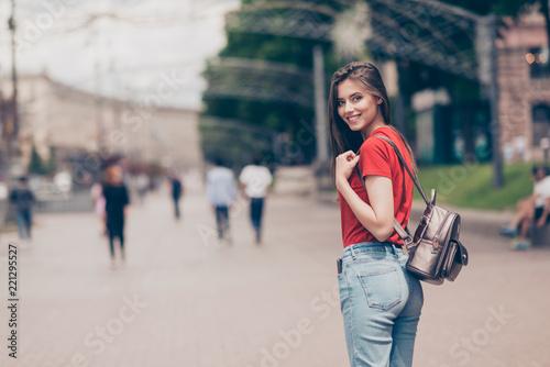 Leinwandbild Motiv Straight-haired young beautiful smiling girl wearing casual red