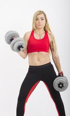 Muscular woman lifting barbells. White background © sigitas1975