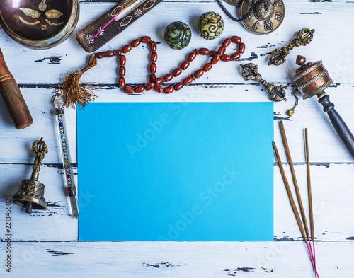 Fototapeta Copper singing bowl, prayer beads, prayer drum