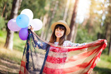 Beautiful patriot woman smile with american flag and colorful balloons - 221352953