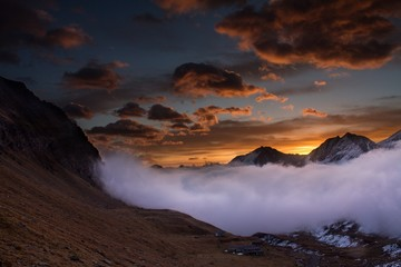 Great view of the foggy valley in Gran Paradiso National Park,  Alps, Italy,  dramatic scene, beautiful world. colourful autumn morning,scenic view with cloudy sky, majestic dawn in mountain landscape © Ji
