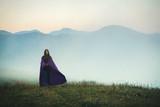 Young Girl Walk through the Fog - 221353753